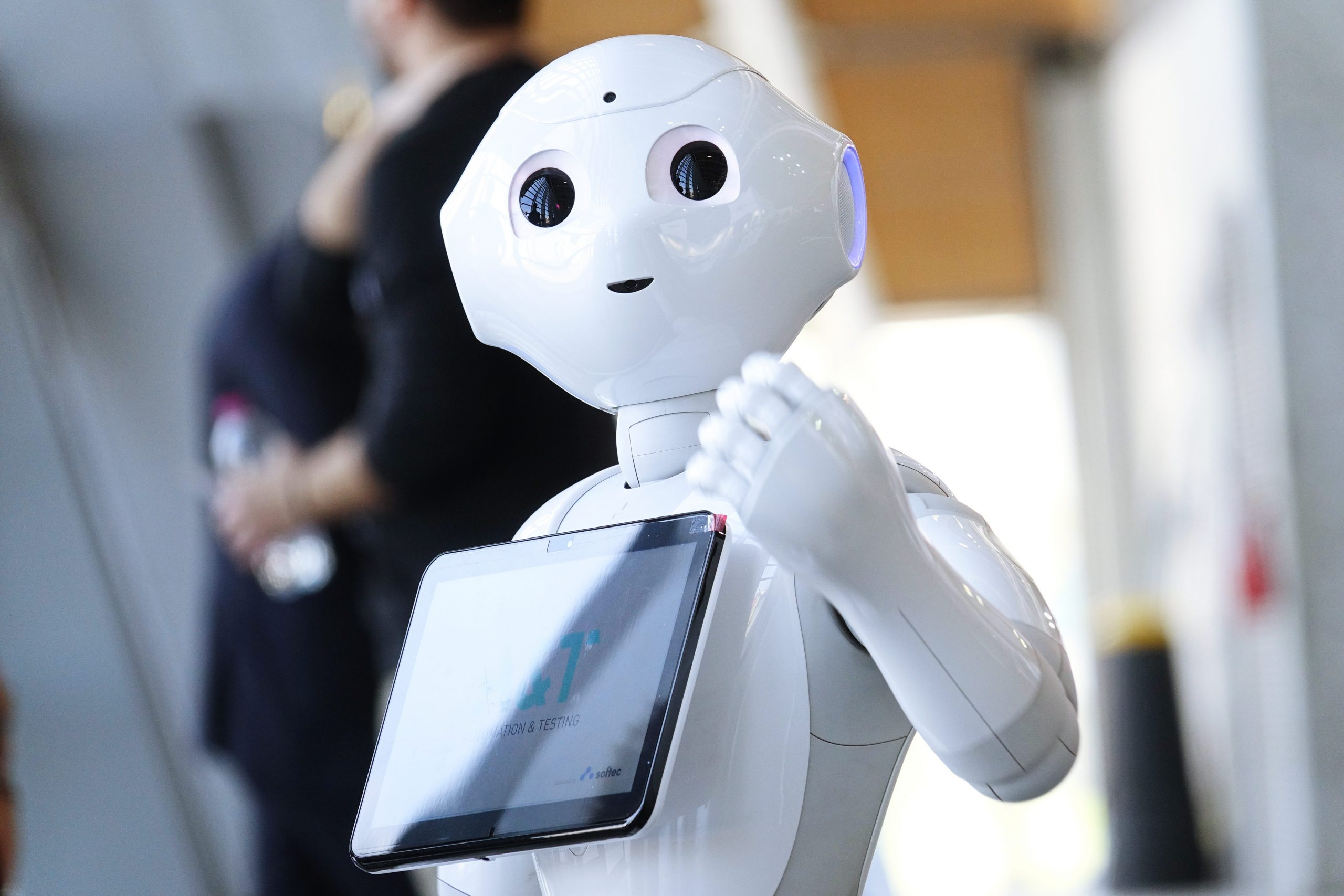 Friendly robot assistant with a digital screen to give information