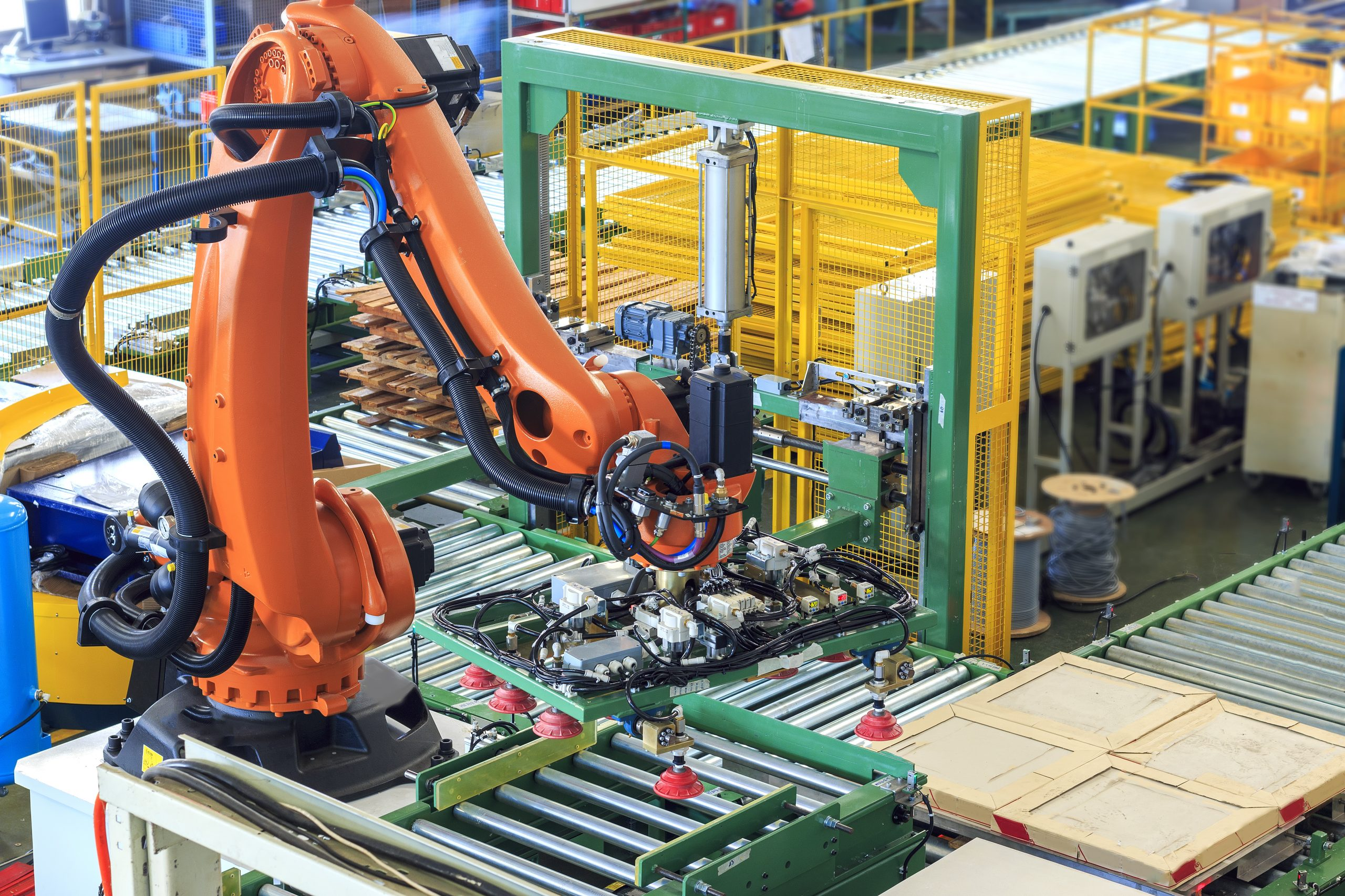Industrial robot in an automated factory process assembles a circuit board
