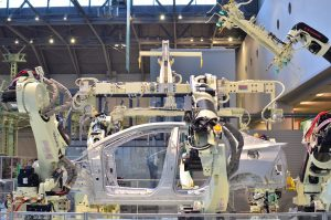Robotic arms assembling a vehicle