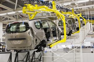 Car chassis suspended on assembly line