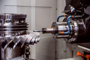 Metalworking CNC milling machine cutting turbine blades.